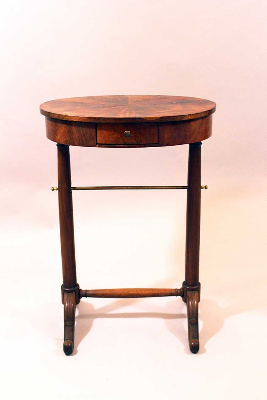 Small French directoire oval working table on two round column feet, each with two extended legs and bronze connection, one drawer and oval top - photo 1