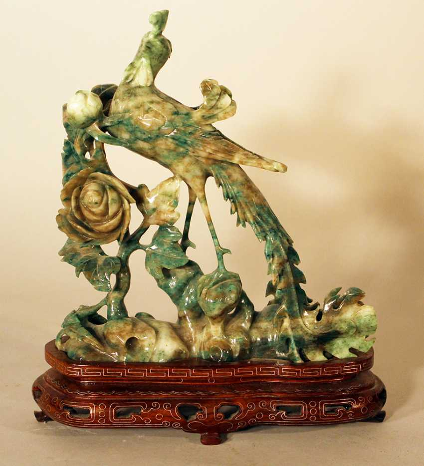 Chinese jade bird sculpture with open work flowers on grey and green colours - photo 1