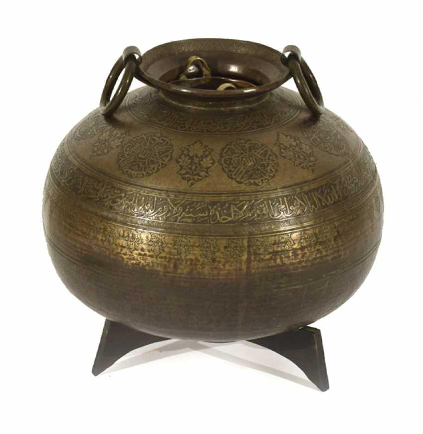 Large, ball-shaped metal basin with a circular Arabic inscription - photo 1