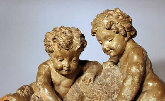 French sculpted terracotta group with two boys playing with water by a source, on integrated stepped base - photo 2