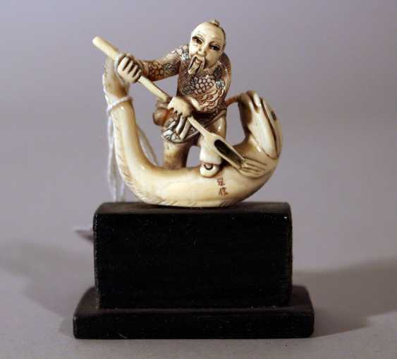 Japanese ivory netsuke with a man standing on a fish with fine engravings and signature on the fish - photo 1