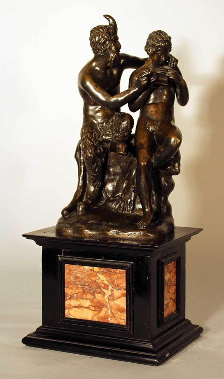 A French bronze group of Satyr and Pan playing the flute and sitting on a rock - photo 1