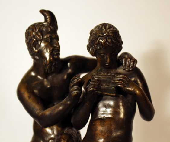A French bronze group of Satyr and Pan playing the flute and sitting on a rock - photo 3