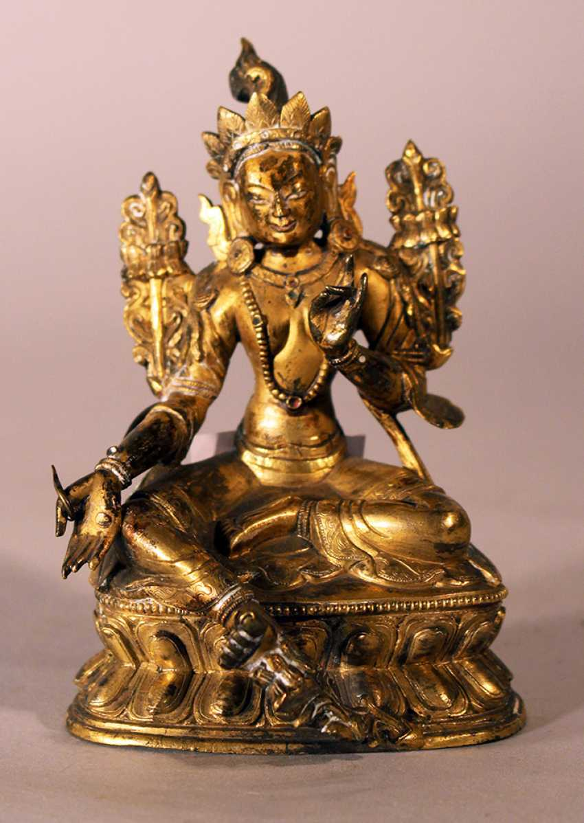 Bronze sculpture of Green Tara with crown, floral decorations on the sides and the hands and feet in blessing ceremonial position, one foot with earth contact - photo 2