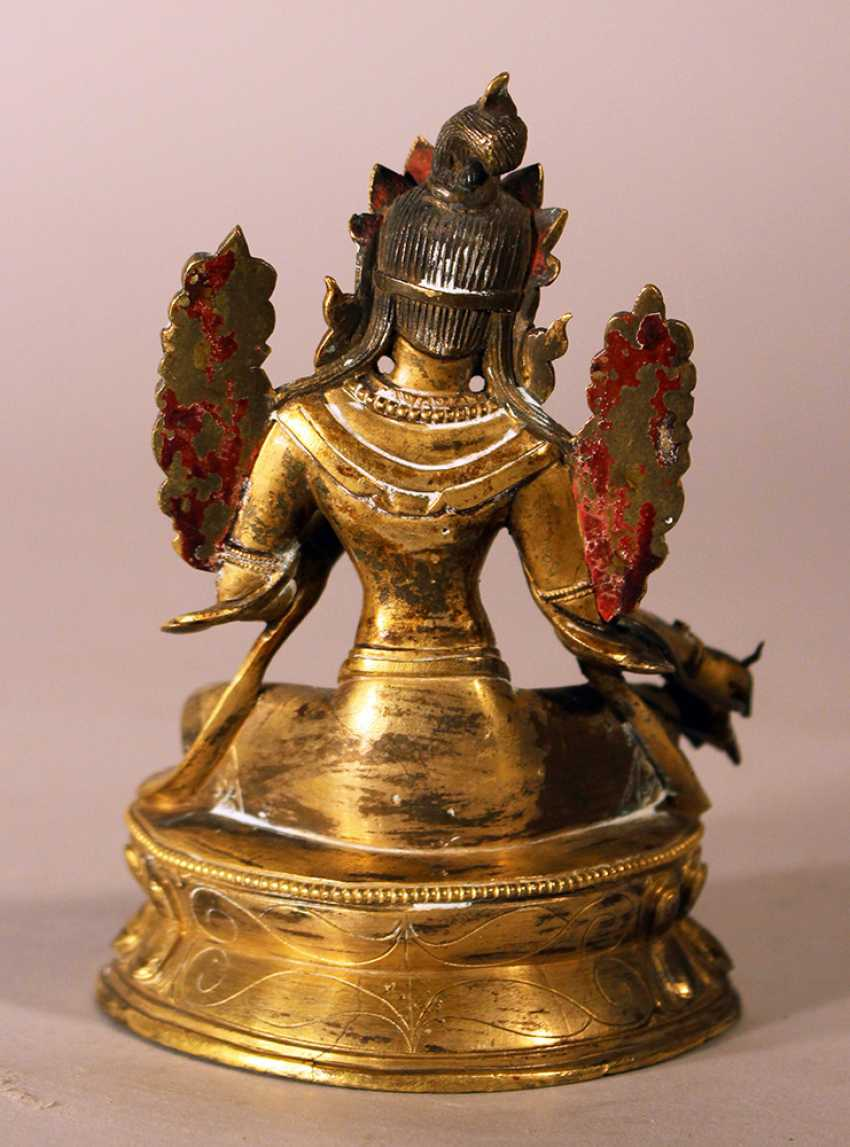 Bronze sculpture of Green Tara with crown, floral decorations on the sides and the hands and feet in blessing ceremonial position, one foot with earth contact - photo 3