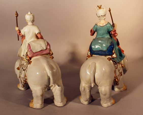 A pair of porcelain elephants with a queen and a king with servants on top - photo 3