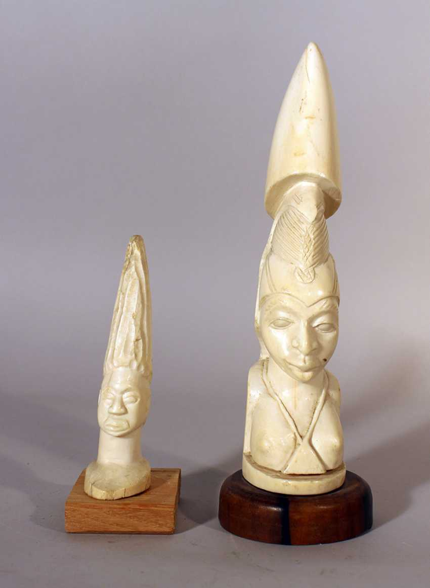 Two African ivory sculptures of male and female portraits, on wooden stands - photo 1