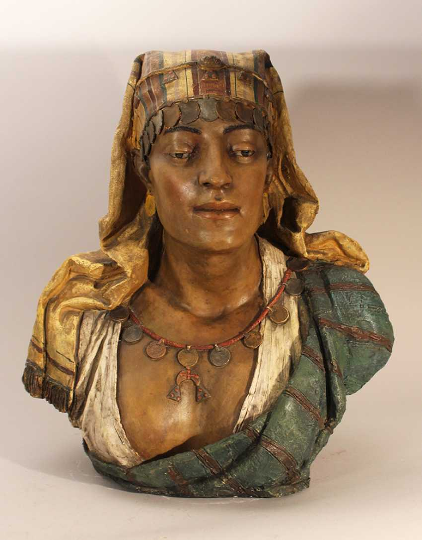 A Goldscheider terracotta bust of an oriental lady, with cape, coins and waved dress - photo 1