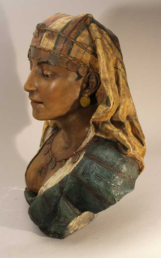 A Goldscheider terracotta bust of an oriental lady, with cape, coins and waved dress - photo 2
