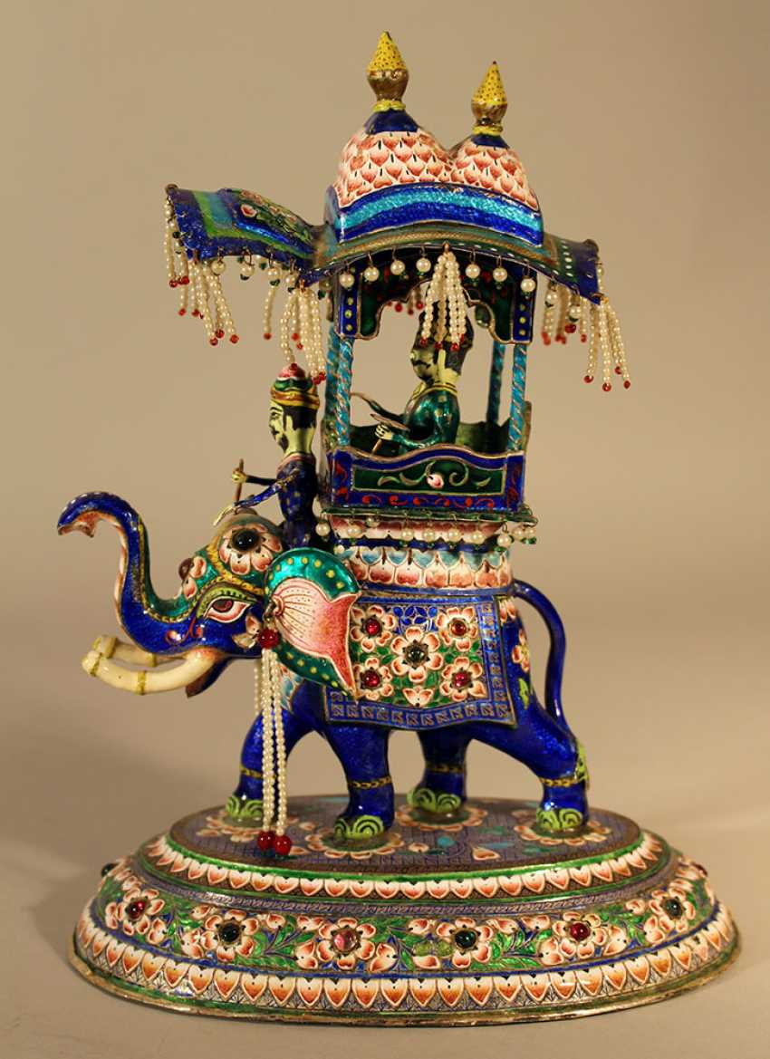 An Indian silver enamel elephant with a cabbin with a Maharaja an his elephant rider on top - photo 1