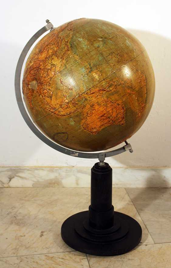 Library geographical globe with upstanding hightened mountain areas, with rivers and sea currents - photo 1
