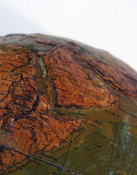 Library geographical globe with upstanding hightened mountain areas, with rivers and sea currents - photo 3