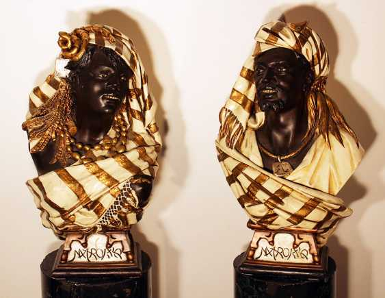 A pair of terracotta busts of Marrocanian couple in traditional dress with jewelry and capes - photo 1