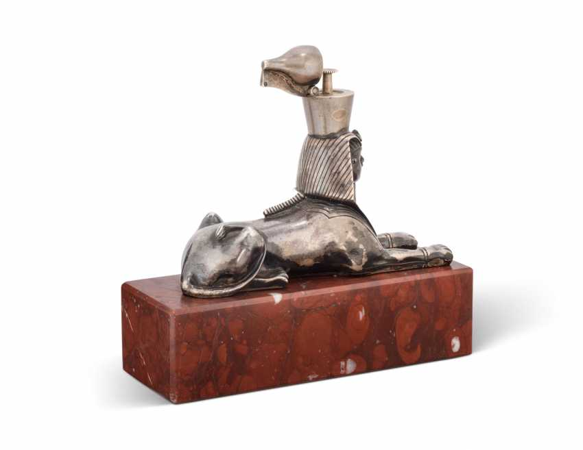 A SILVER TABLE LIGHTER IN THE FORM OF A SPHINX - photo 3