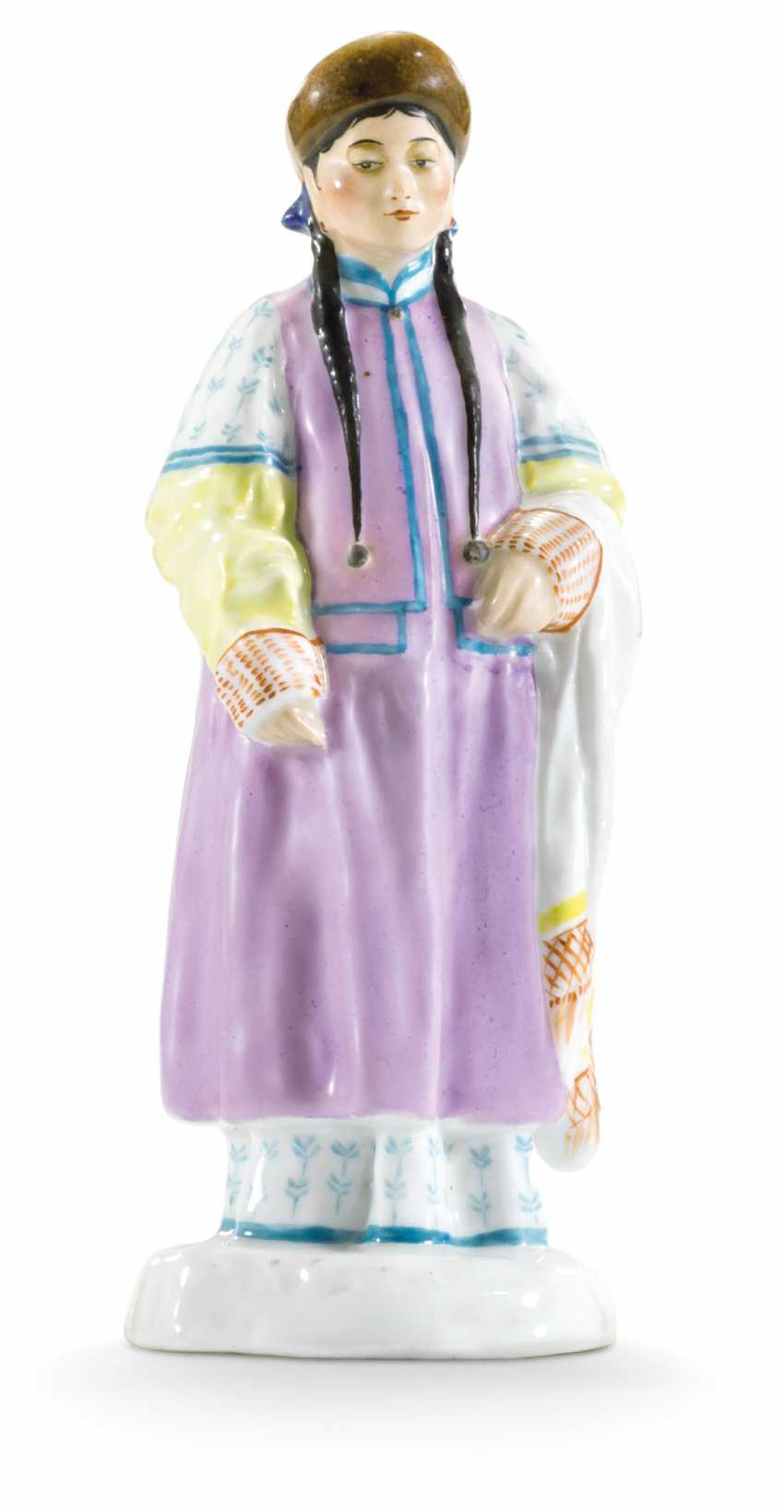 A PORCELAIN FIGURE OF A BURYAT WOMAN FROM THE 'PEOPLES OF RUSSIA' SERIES - photo 1