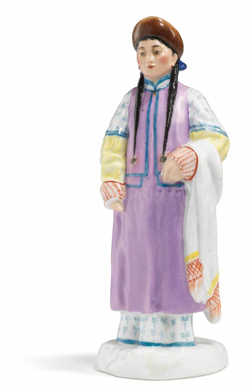 A PORCELAIN FIGURE OF A BURYAT WOMAN FROM THE 'PEOPLES OF RUSSIA' SERIES - photo 2