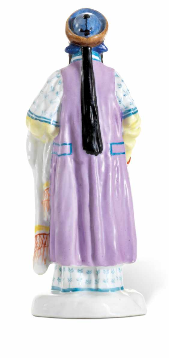 A PORCELAIN FIGURE OF A BURYAT WOMAN FROM THE 'PEOPLES OF RUSSIA' SERIES - photo 3