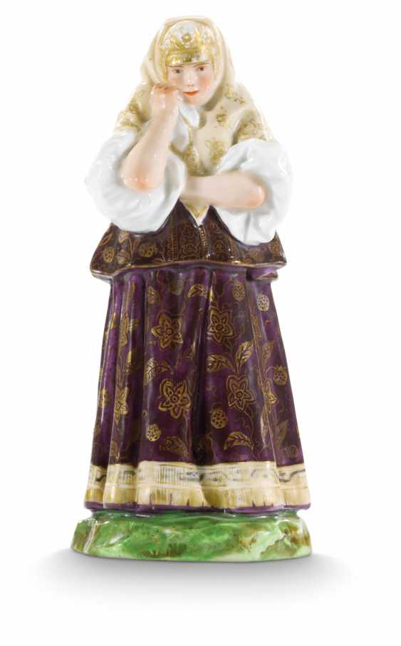 A PORCELAIN FIGURE OF AN OLONETSK WOMAN FROM THE 'PEOPLES OF RUSSIA' SERIES - photo 1