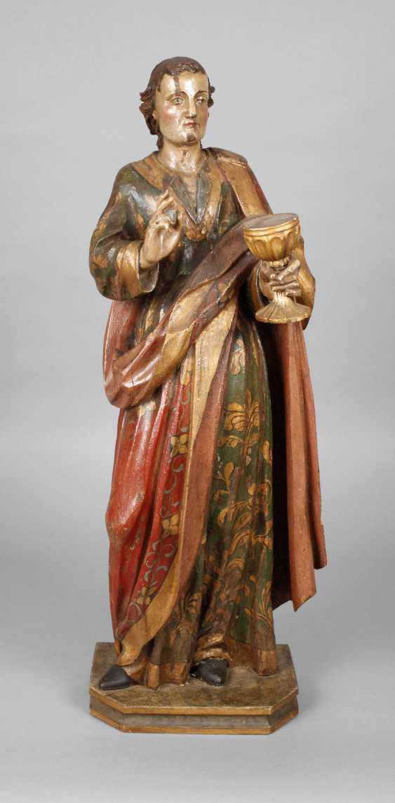 Large carved Saint statue in case - photo 1