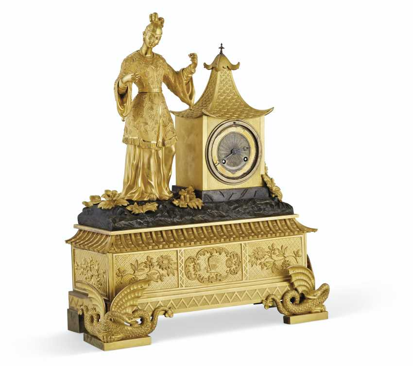 A LOUIS PHILIPPE ORMOLU AND PATINATED-BRONZE MANTEL CLOCK - photo 1