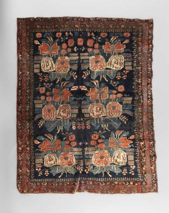 Fragment of a Persian carpet - photo 1
