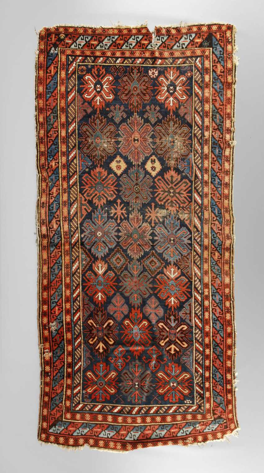Fragment of a Caucasian rug - photo 1