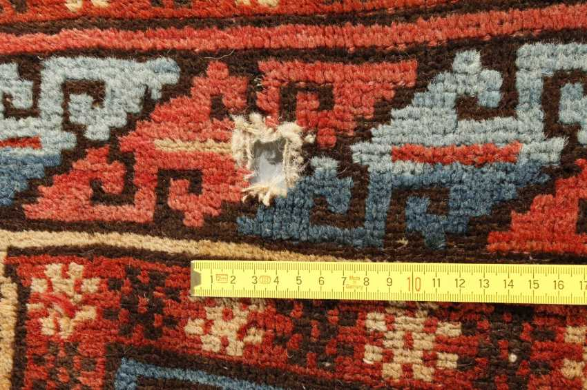 Fragment of a Caucasian rug - photo 2