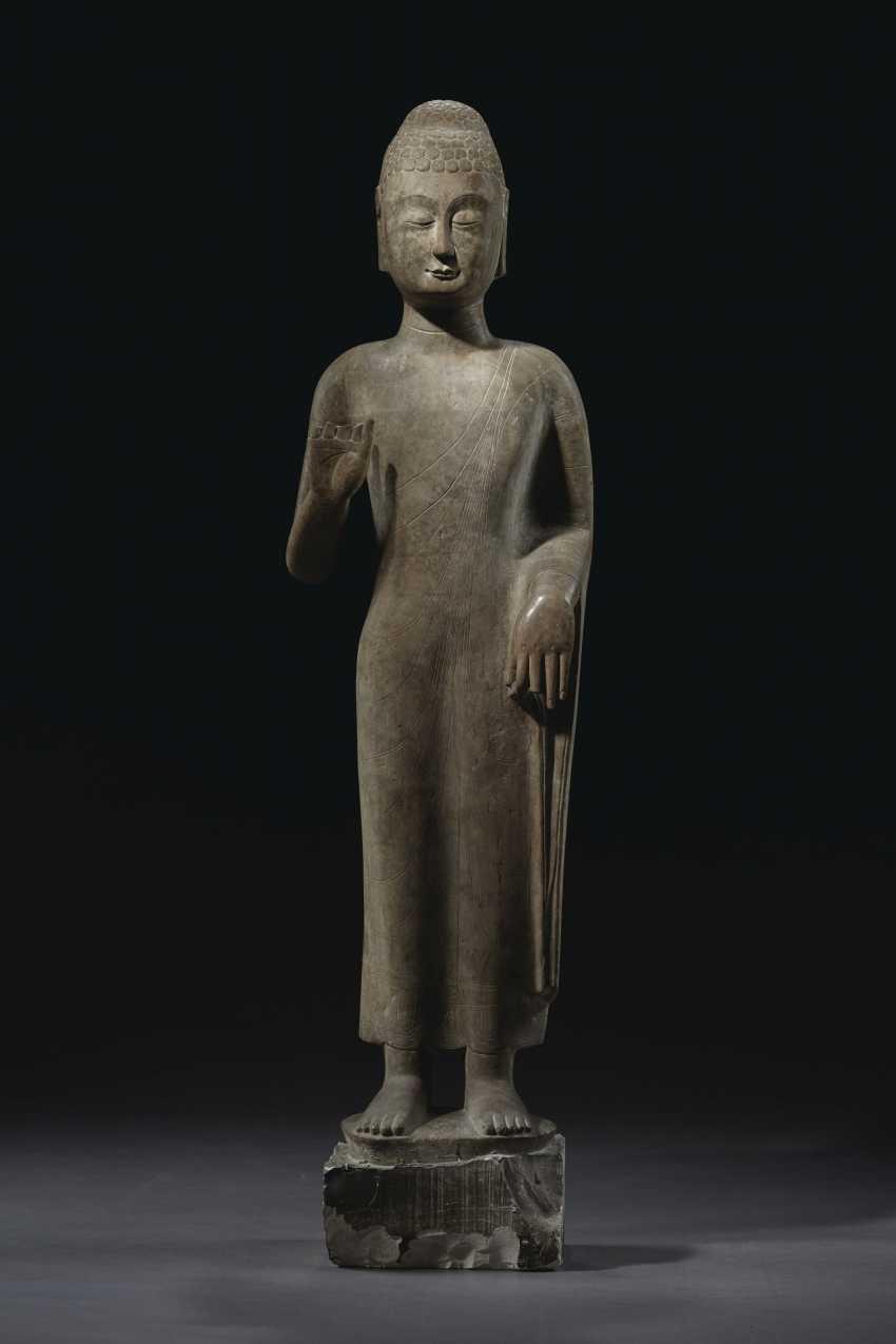 A MAGNIFICENT LARGE GREY LIMESTONE STANDING FIGURE OF BUDDHA... - photo 1
