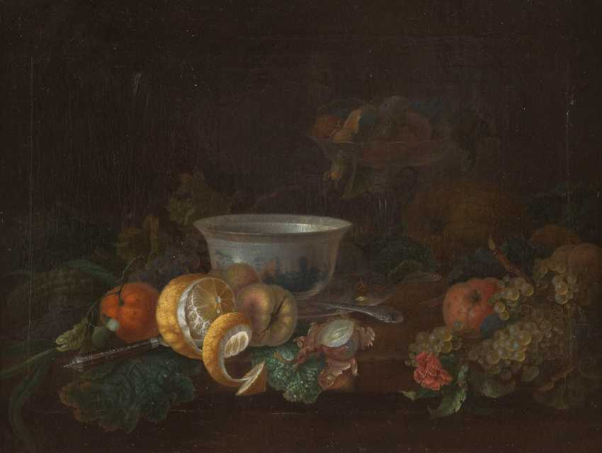 Still life with fruits, porcelain cup and bowl - photo 1