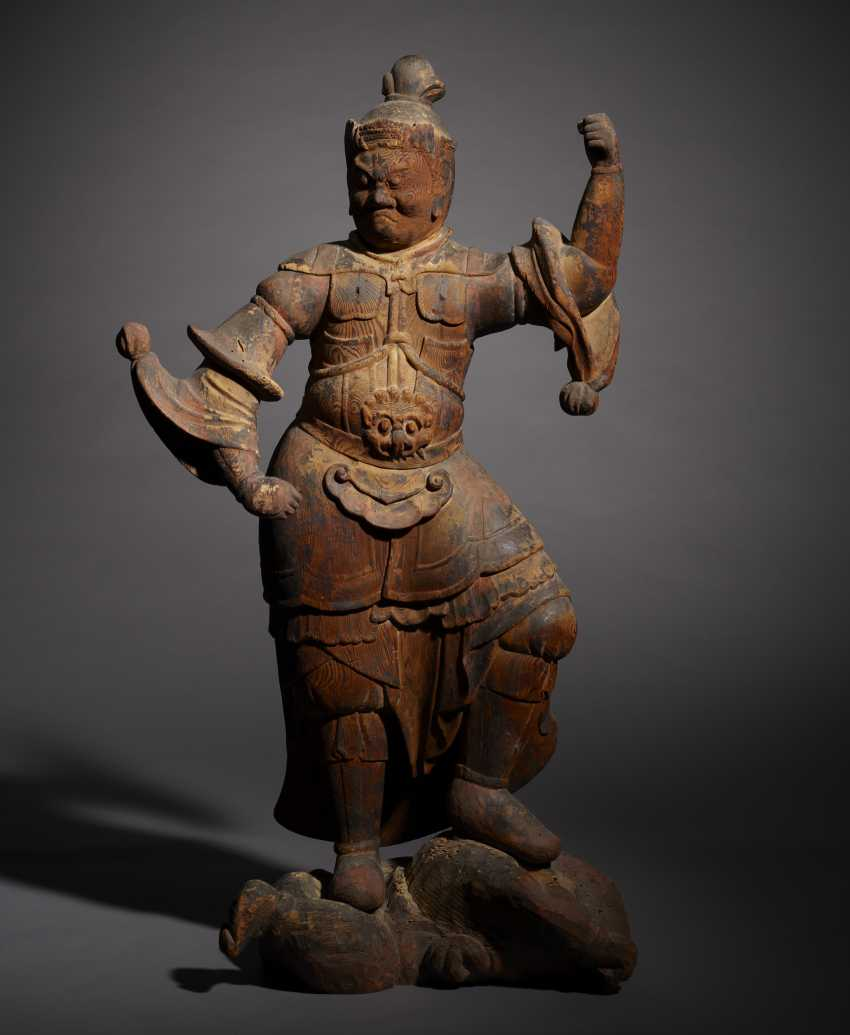 A CARVED WOOD FIGURE OF GUARDIAN KING - photo 1