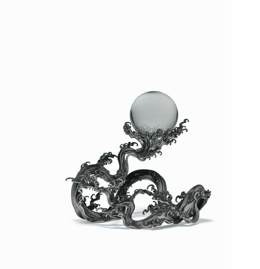 A ROCK CRYSTAL SPHERE ON A SILVER WAVE STAND - photo 1