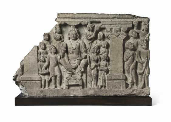 A GRAY SCHIST RELIEF WITH THE BODHISATTVA MAITREYA AND DEVOT... - photo 1
