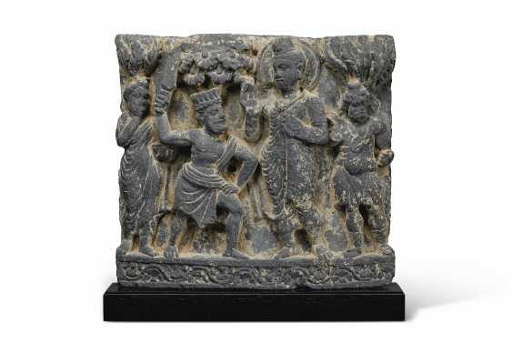 A GRAY SCHIST RELIEF DEPICTING BUDDHA SHAKYAMUNI CONFRONTED ... - photo 1