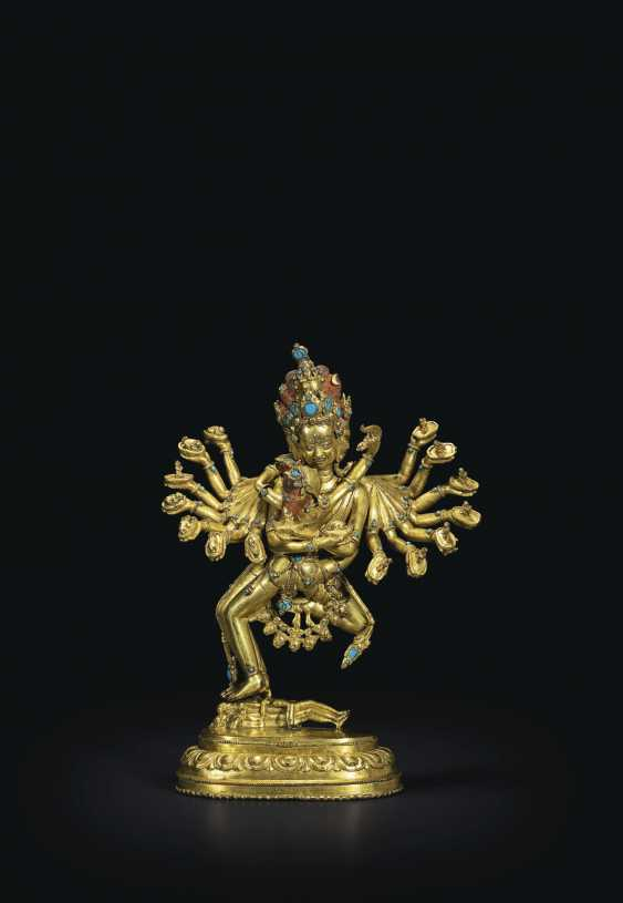 AN IMPORTANT GILT-BRONZE FIGURE OF KAPALADHARA HEVAJRA - photo 1