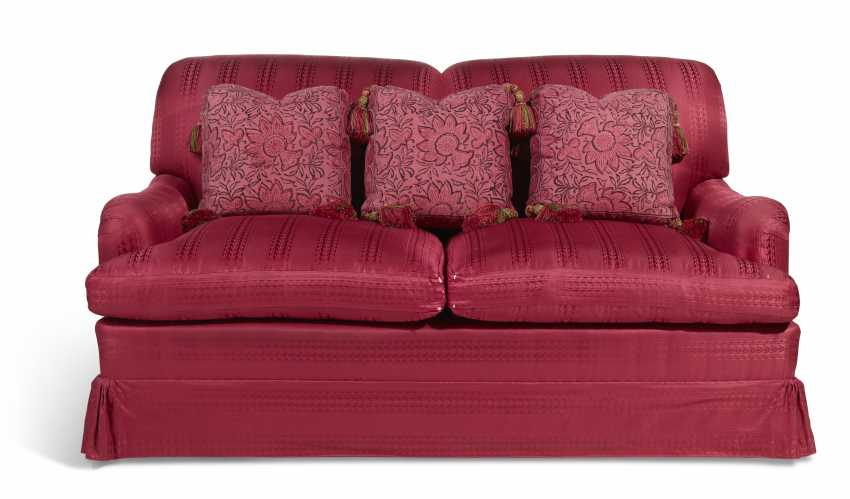 A RED SILK UPHOLSTERED TWO-SEAT SOFA - photo 1