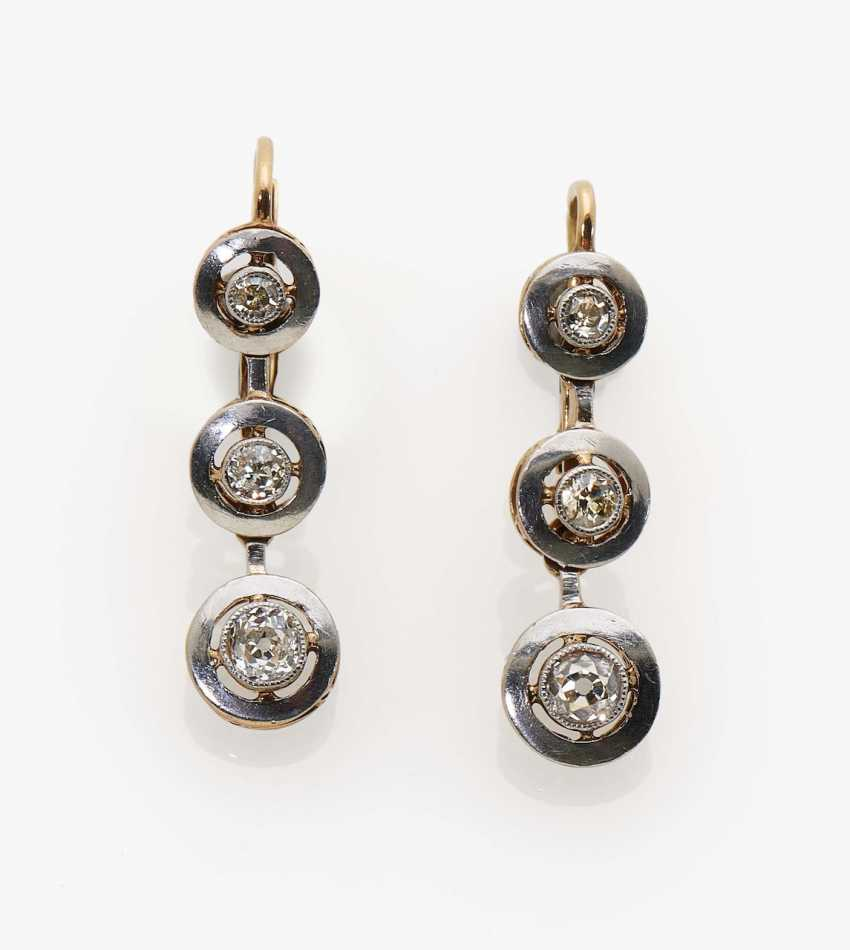 A pair of earrings with diamonds - photo 1