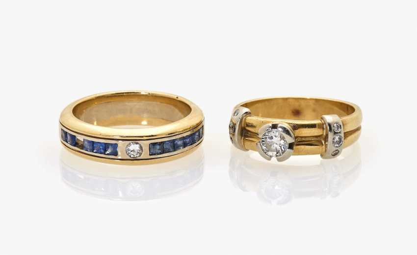 Two band ring-like rings with diamonds and sapphires - photo 1
