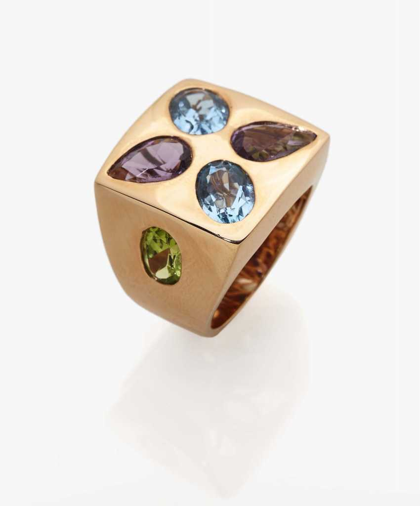 Cocktail ring with topazes, peridots and amethysts - photo 1