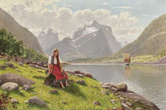Young Norwegian woman on the bank of a fjord - photo 1