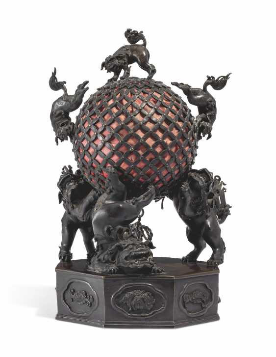A BRONZE LAMP WITH KARASHISHI SUPPORTING A PIERCED BALL - photo 1
