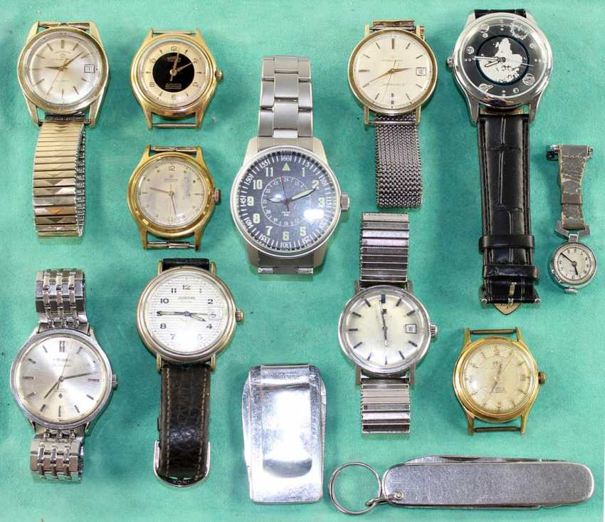 Collection of men's wristwatches - photo 1