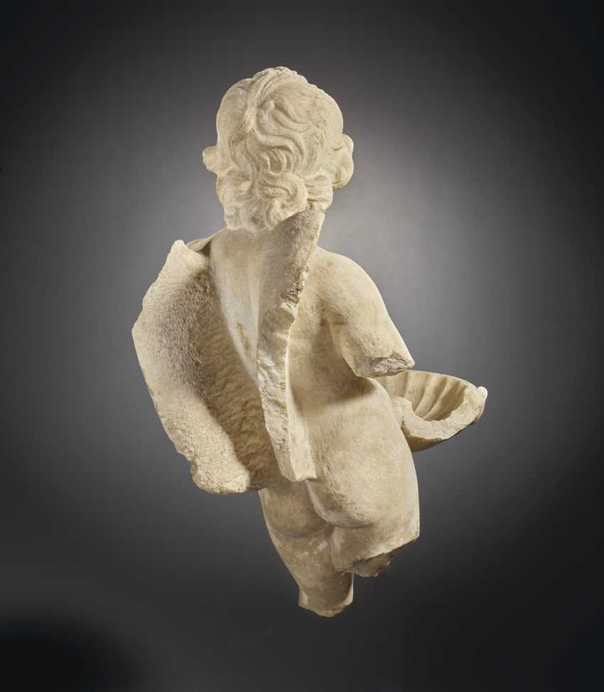 A ROMAN MARBLE EROS WITH A SHELL - photo 4