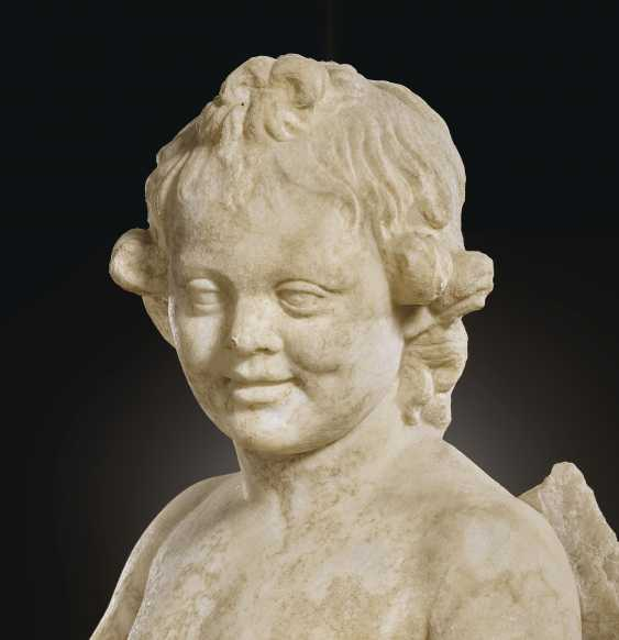 A ROMAN MARBLE EROS WITH A SHELL - photo 5