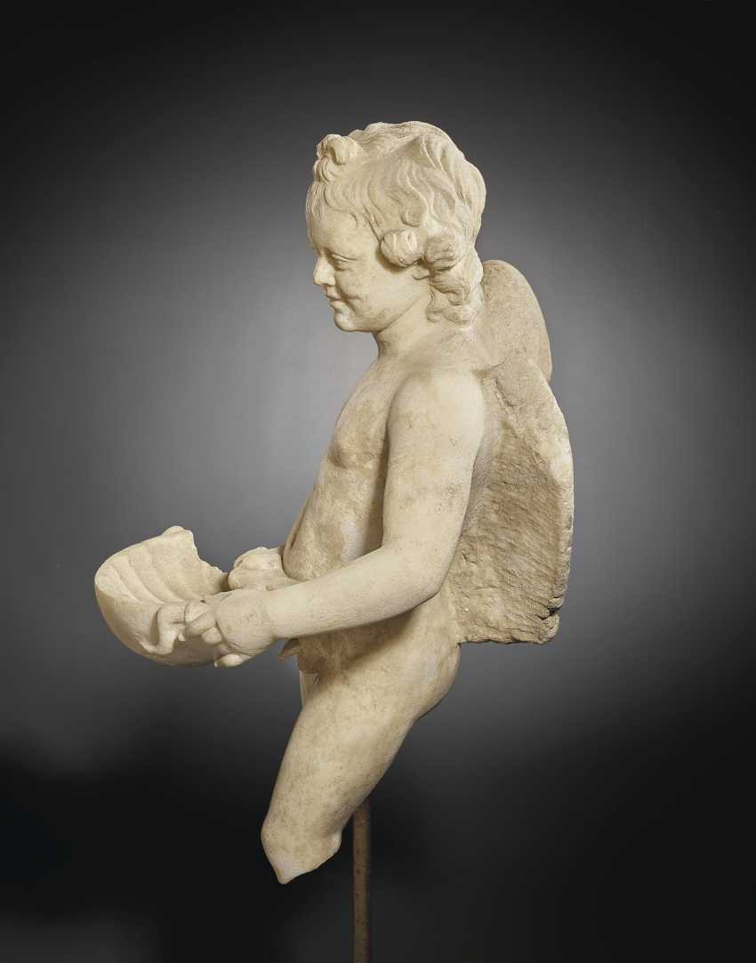 A ROMAN MARBLE EROS WITH A SHELL - photo 7