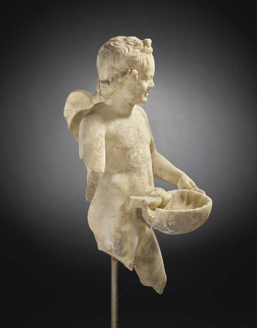 A ROMAN MARBLE EROS WITH A SHELL - photo 8