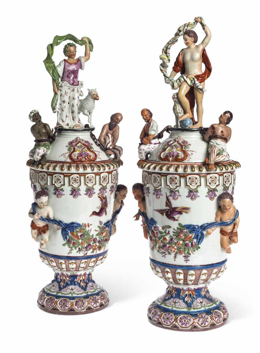 A PAIR OF VIENNA (DU PAQUIER) PORCELAIN VASES AND COVERS EMB... - photo 1