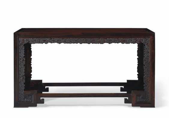 A CARVED ZITAN CORNER-LEG TABLE - photo 1