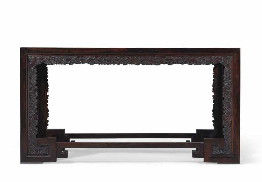 A CARVED ZITAN CORNER-LEG TABLE - photo 3