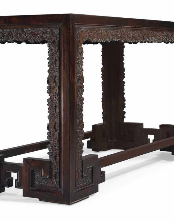 A CARVED ZITAN CORNER-LEG TABLE - photo 4