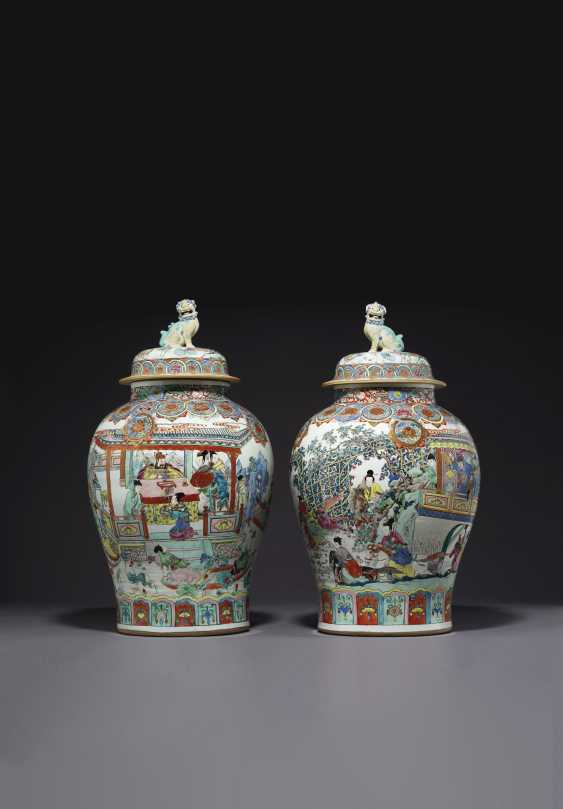 A LARGE PAIR OF CHINESE FAMILLE ROSE JARS AND COVERS - photo 1